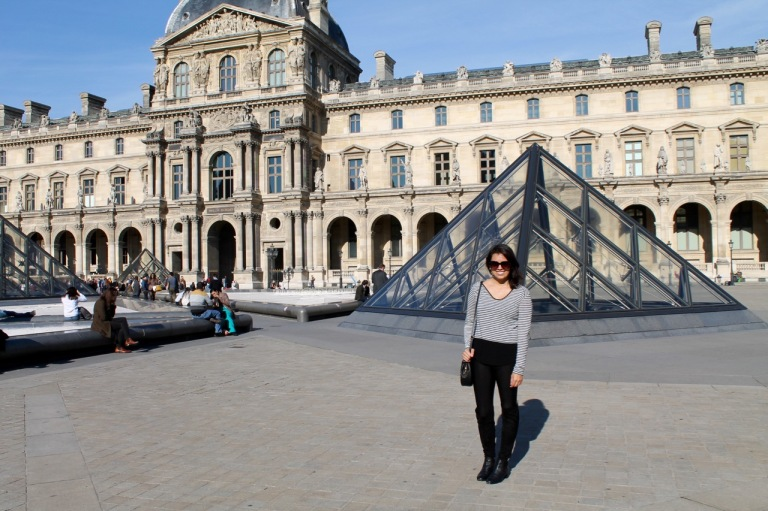 Standing outside of the Louvre in Paris